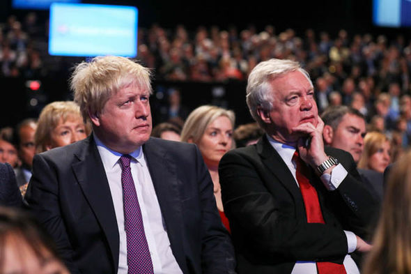Tory party chaos: Johnson and Davis  Tory party week of CHAOS: Boris senses Theresa May is 'wounded animal' as Trump takes aim | Politics | News Tory party chaos 1419464