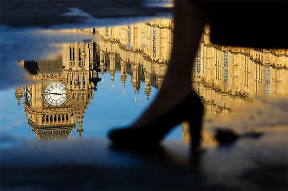 Big Ben reflected in a puddle