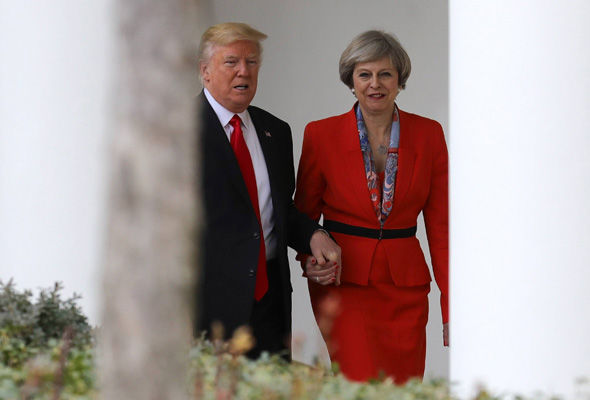 Donald Trump and Theresa May were photographed holding hands before their first press conference