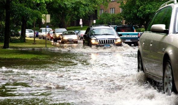 Flooded street with cars