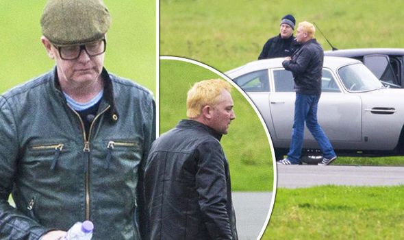 Chris Evans looks glum as he shoots Top Gear for the first