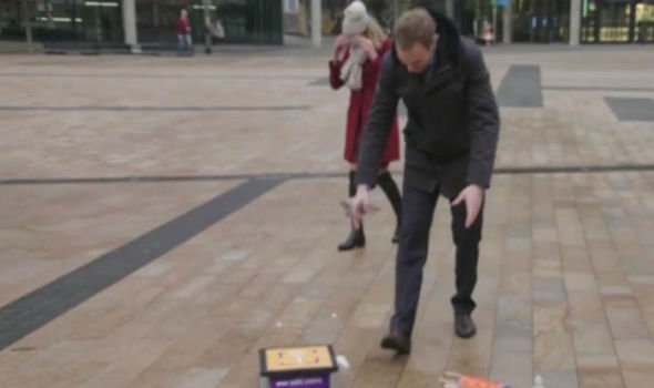 Dan Walker runs to retrieve his rocket on BBC Breakfast