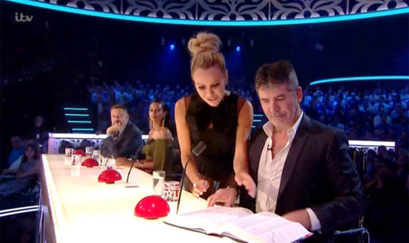 Amanda Holden helps Simon Cowell read a book on Britain's Got Talent