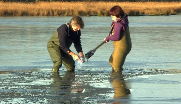 Martin and Dr Ross drill holes in the lake