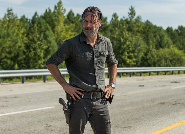 Rick Grimes stands in the middle of a road