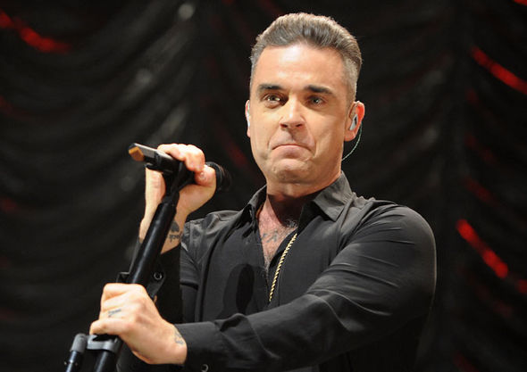 Robbie Williams performing