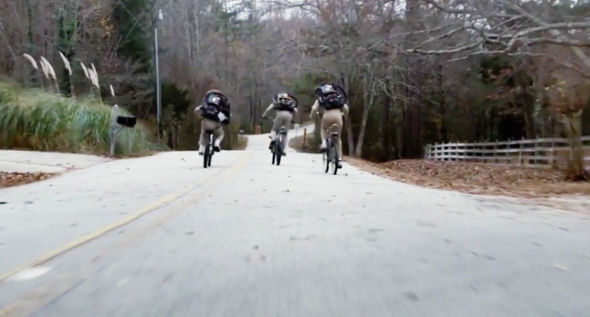 The boys are seen darting off on their bicycles
