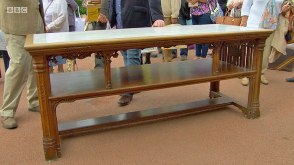 This marble topped wooden table was valued at £20,000 on Antiques Roadshow