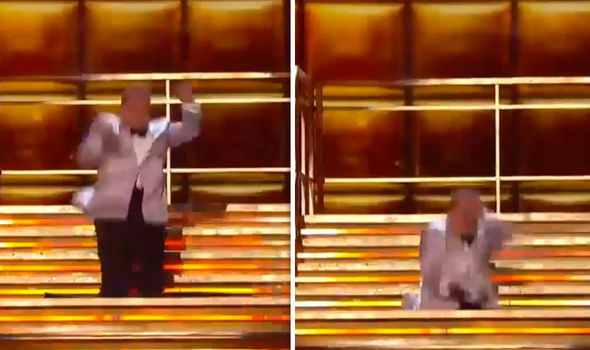 James Corden falls down hole