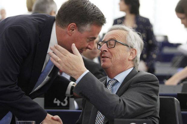 Jean-Claude Juncker greets David James 'Mac' McAllister former Prime Minister of the German state of Lower Saxony
