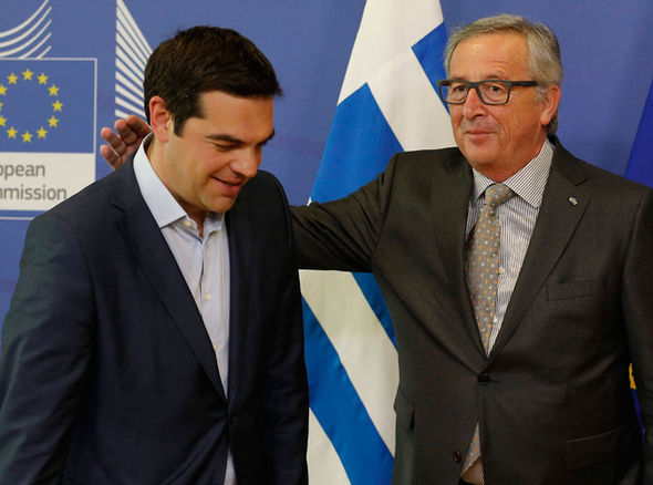 Jean-Claude Juncker puts a hand round Alexis Tsipras's shoulder