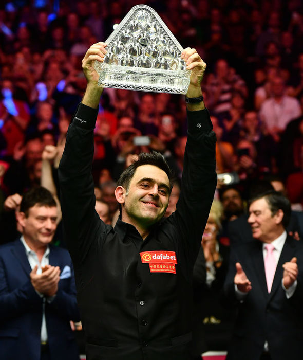 Ronnie O'Sullivan holds the title aloft