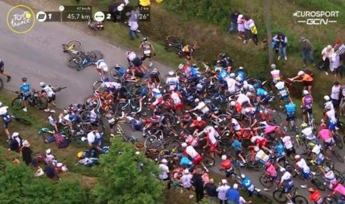 Tour de France crash: Fan causes huge pile up in peloton as Tony Martin collides with sign