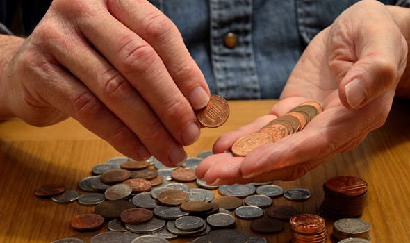 Person counting pennies  Pensions news: Workers retiring in 2018 can expect RECORD high | Retirement | Finance savings2 1191269