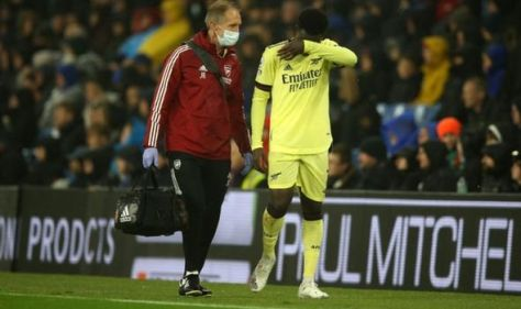 Arsenal star Bukayo Saka limps off after heavy tackle in Brighton clash
