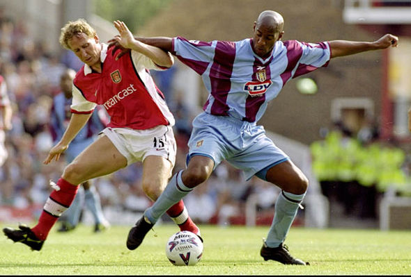 Dion Dublin playing against Arsenal