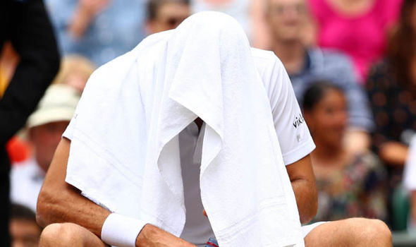 Marin Cilic put a towel over his head to try and compose himself