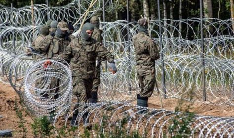 Poland defies EU warning with '£300m plan' to build border wall with Belarus