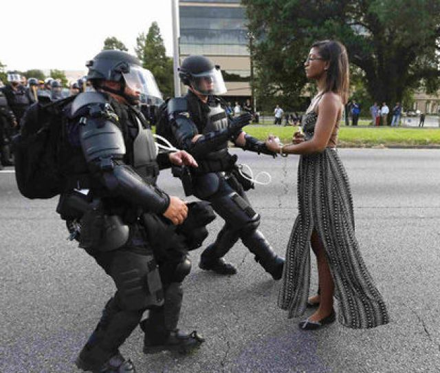 Woman Stands In Front Of Police Officers
