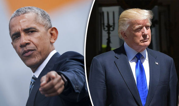 Barack Obama took aim at Donald Trump as he shared the stage with Angela Merkel