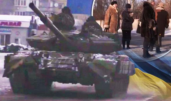 Avdiivka residents and tank