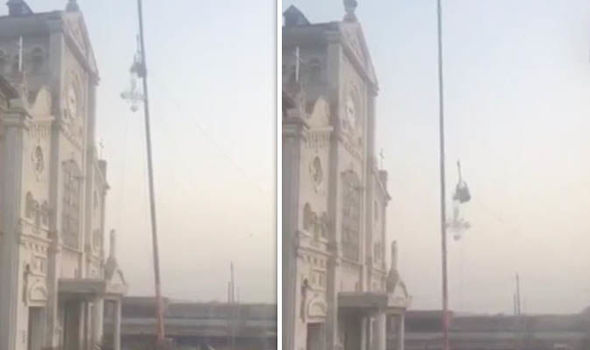 Chinese authorities tearing down a cross from a church