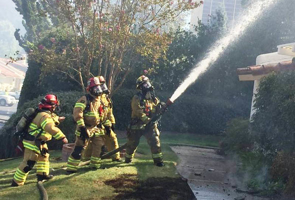 Firefighters at the scene of the Aliso Viejo explosion
