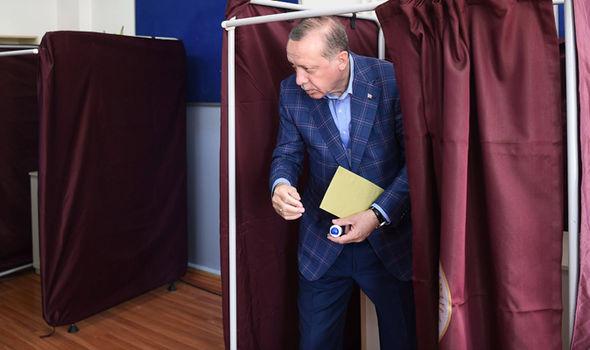 President Erdogan emerges after voting