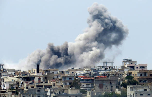 Smoke rising after a bombing raid in Syria