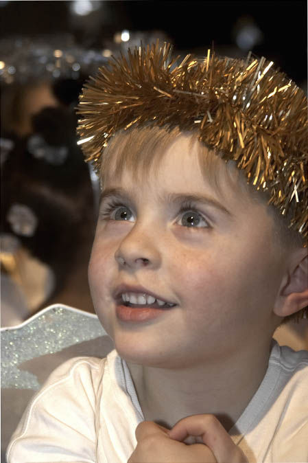 Boy in angel costume for school nativity