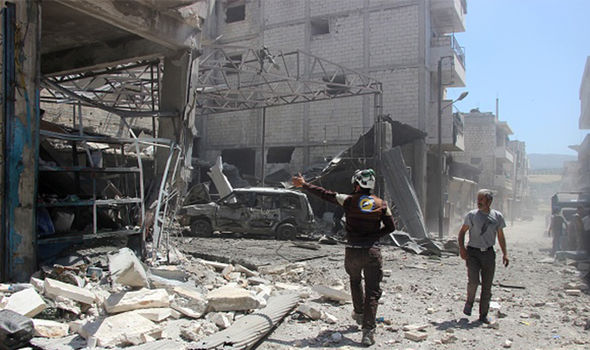 Civil defence crews conduct search and rescue works after airstrikes hit residential area in Syria