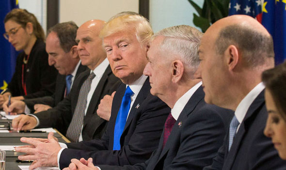 Donald Trump (C) and US defence minister, James Mattis meets with Donald Tusk