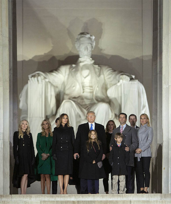 Trump and his family by the memorial