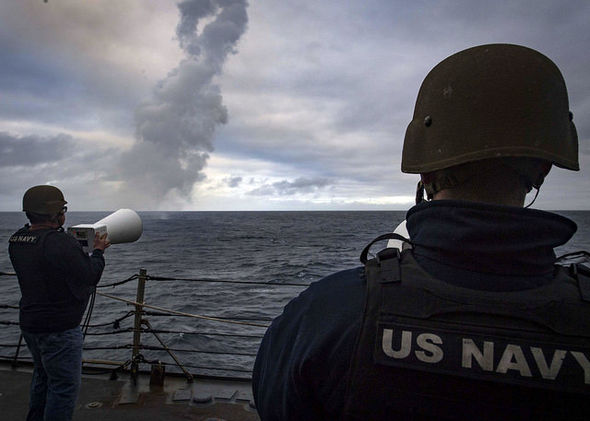 Soldiers watch as combined navies test a missile interception