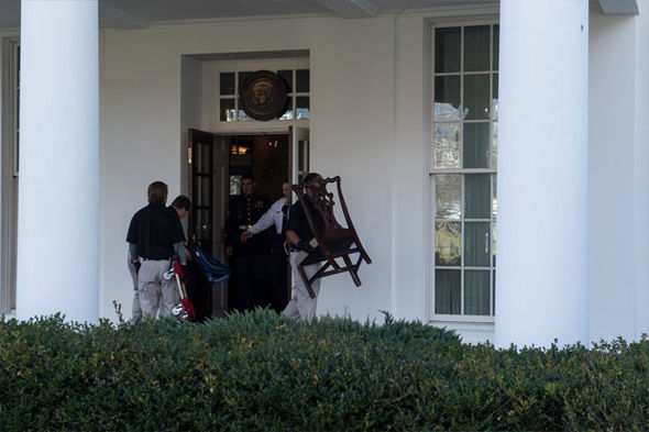 Furniture is carried out of the West Wing of the White House as Trump prepares to move in