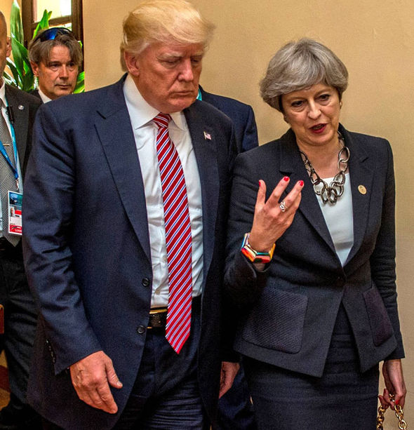 G7 summit: Theresa May walks with Donald Trump during the G7