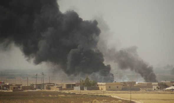 An ISIS compound in flames after an airstrike