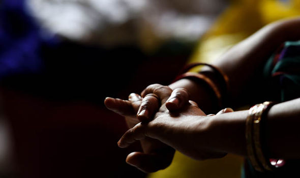 Indian woman's hands crossed in lap