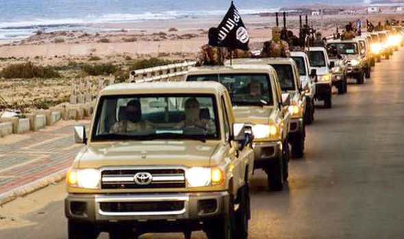 Cars with Islamic State flags drive through Sirte
