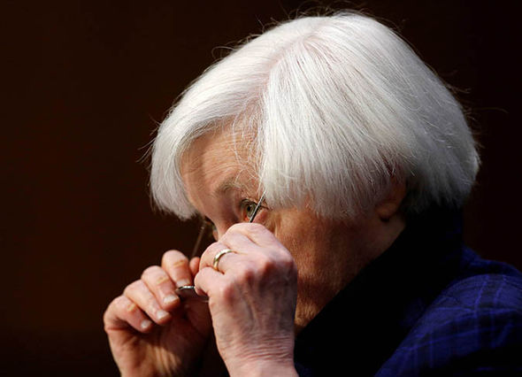Janet Yellen taking glasses off