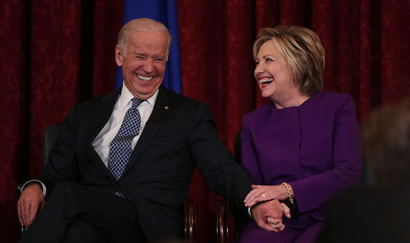 Joe Biden shares a joke with defeated Democrat Hillary Clinton