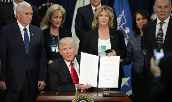 Trump signs executive order with homeland security