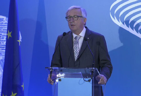 European Commission President Jean-Claude Juncker was quick to defend ally German Chancellor Angela Merkel