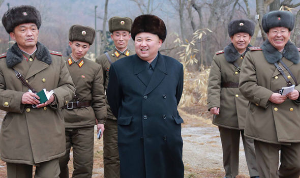 Kim Jong-un pictured with military officials ahead of a possible missile launch