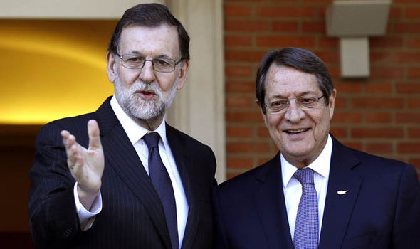 Spanish Prime Minister, Mariano Rajoy greets his Cypriot counterpart, Nicos Anastasiadis