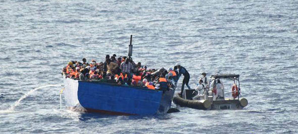 Migrants arriving on overcrowded boats last year