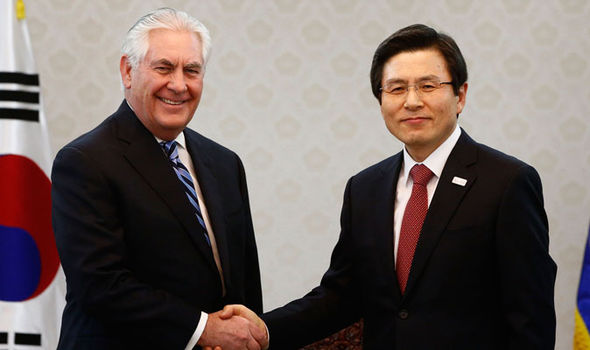 Mr Tillerson with his South Korean counterpart during a visit to East Asia