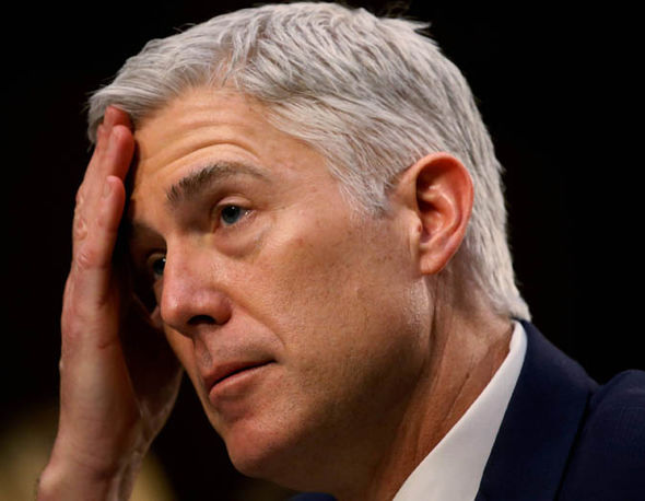 Neil Gorsuch listens to a question