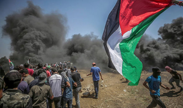 Palestinian protesters take part during clashes after protests near the border with Israel in the east of Gaza Strip