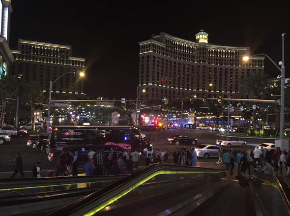 People gather outside the Bellagio hotel